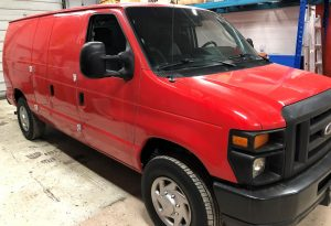 Vinyl Wrap Toronto Ford E150 2014 Removal Red White Van Before Side2