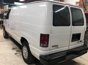 Vinyl Wrap Toronto Ford E150 2014 Removal Red White Van Main - Vinyl Remove